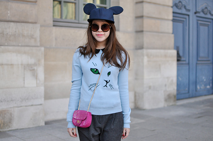 Girl with cat motif pullover and hat