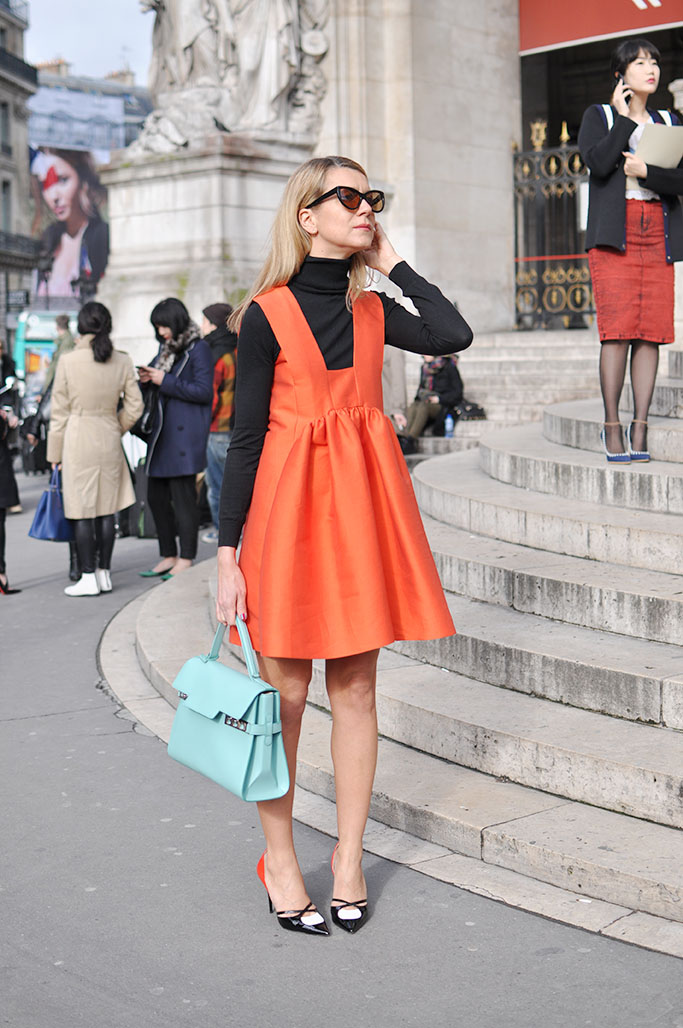Natalie Joos, orange stella mccartney dress