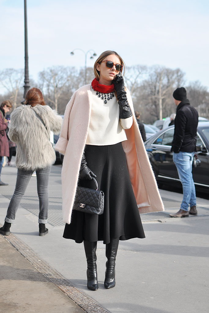 Girl in a pink coat and a midi skirt